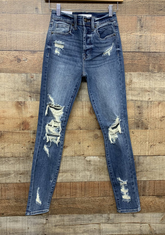 BELLA SUPER HIGH RISE SKINNY WITH INTENTIONALLY DESTROYED AREAS, DESTRUCTED LEG OPENINGS, FADED AND WHISKERING THROUGHOUT