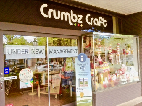 joke signage in crumbs craft's window