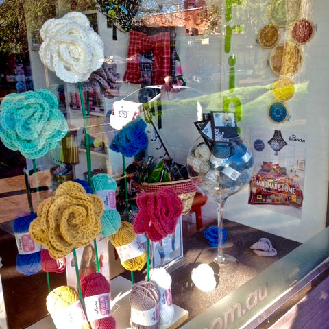 Crochet flowers in Crumbz Craft's window