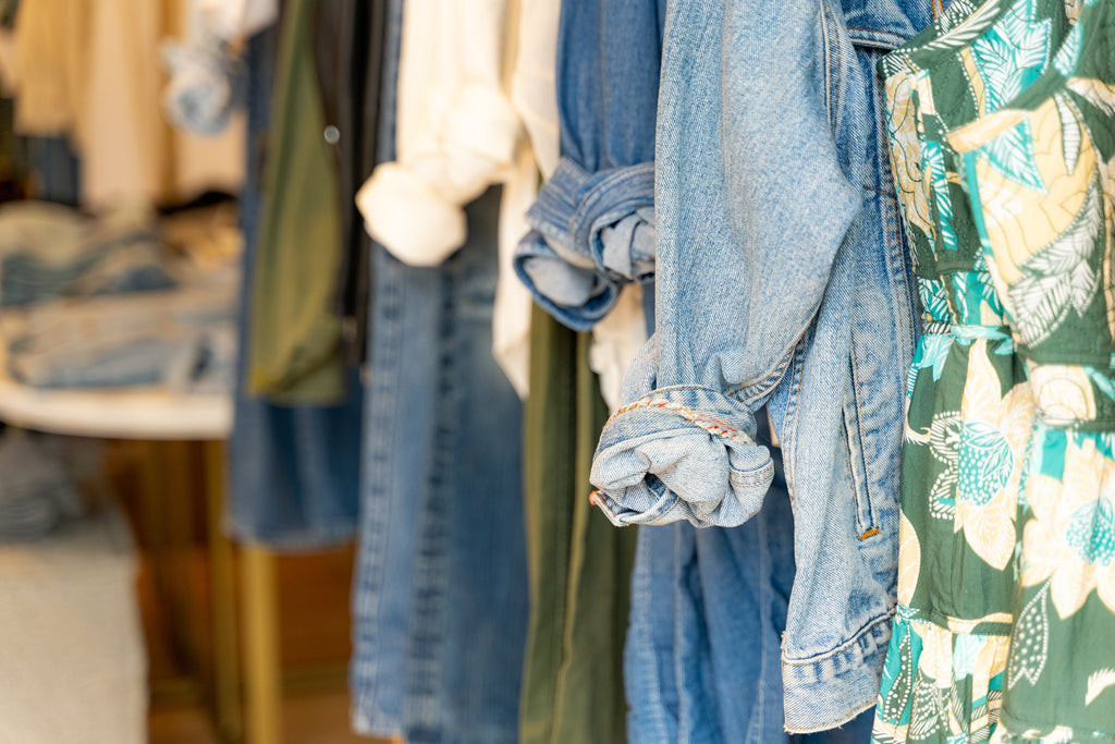 Detail photo of clothes hanging in-store.