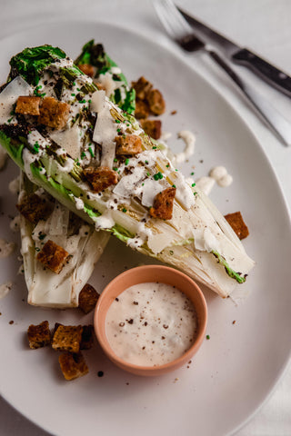platter with grilled romaine deconstructed caesar salad with croutons and parmesan