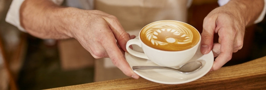 Man holding a coffee in his hands
