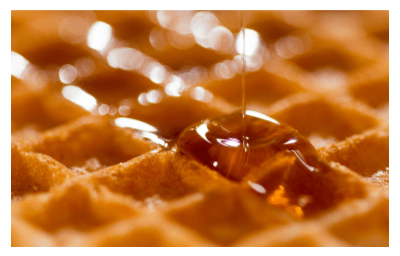 Honey dripping on waffle