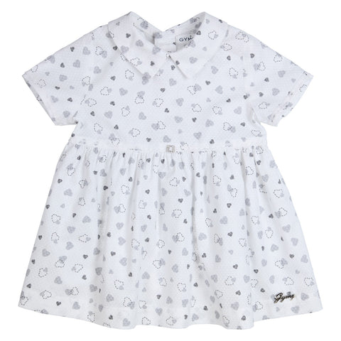 Ref: 470-1411-10  Beautiful white short sleeved dress, with grey heart all over print  Collar  Button fastening down back  Diamante detail on waistband  Small metal GYMP logo on hem  100% cotton  Machine washable 40*