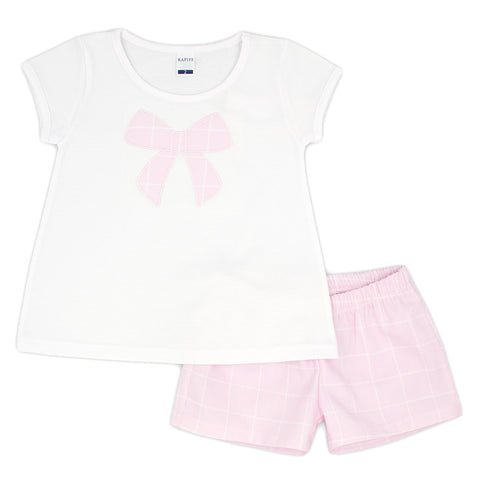 Girls Rapife 2 piece shorts set, ref: 4351  White crew neck top with pink bow patch on front  Pink shorts in matching fabric to bow design  100% cotton  Machine washable 30*
