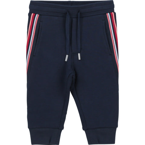 Boys Boss navy jogging bottoms  red stripe down the side of leg  83% cotton, 15% polyester, 2% elastane  machine washable 30*  matching jacket available ref: J05865