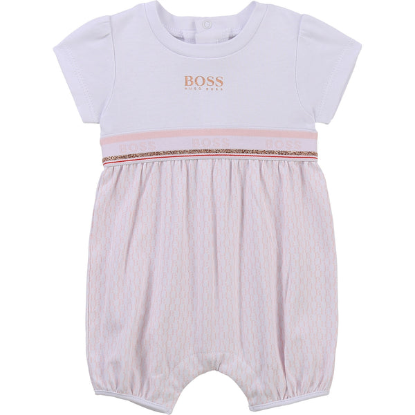 Boss bubble J9428310B Baby girl's bubble  Short sleeves  Popper fastening down back and under legs  BH pink print on bottom, white bodice with gold Boss print  95% cotton  5% elastane  Machine washable 30*