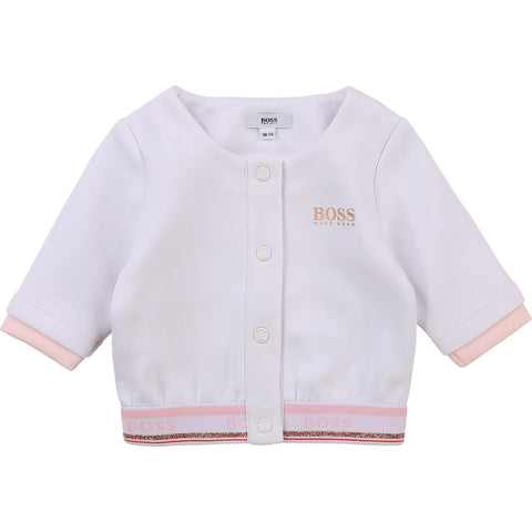 Girls Boss white jacket with gold Boss print on left chest  popper fastening down front  Elasticated welt at bottom with Boss branding and gold sparkle detail   60% cotton 40% polyester  Machine washable 30*