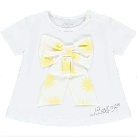 Little A, Kadence, Kamila  2 piece set, top and skirt  Shorts with ruffle skirt, white with lemon sunshine print  White top with large sunshine print front bow  Shorts 97% cotton, 3% elastane  Top 95% cotton, 5% elastane  Sparkle 'Little A' branding on top  Machine washable 30*