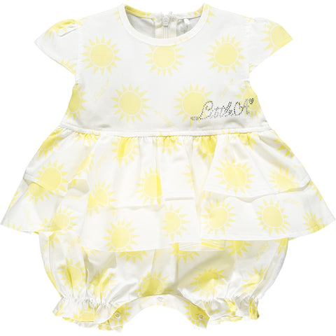 Little A ref: Kacie  Romper with mock overlay dress  Colour - Bright white with lemon sunshine print  Little A sparkle branding on left chest  Zip fastening at back popper fastening under legs  Gorgeous full ruffle layered detail  capped sleeves  Romper with mock overlay dress