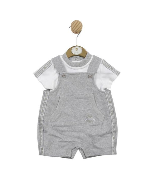 boys grey dungarees in 100% cotton t-shirt fabric. white t-shirt underneath with grey panels on the shoulders. front pouch pocket. short legged. button fastening dungarees