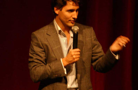 Justin Trudeau speaking in stylish suit