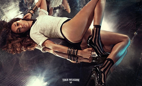 Joan Smalls wearing Ozone Design's Black Sheer Pinstripe Sock for True Religion International Campaign