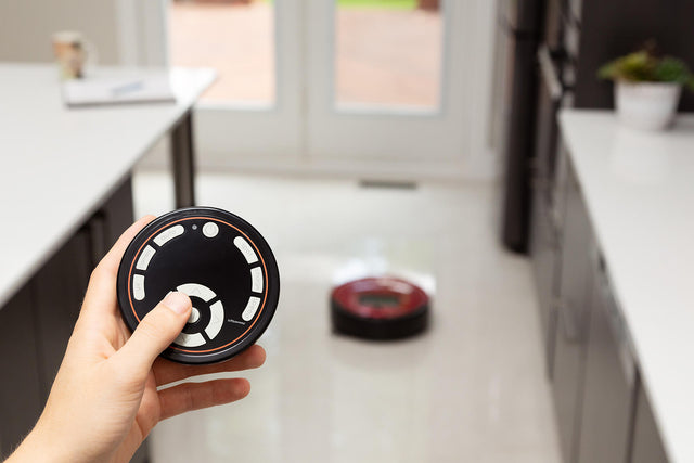 Remote control telling Bob PetHair robotic vacuum to start cleaning.
