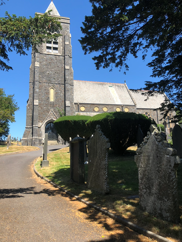 lampeter church with blue sky and graveyard around it