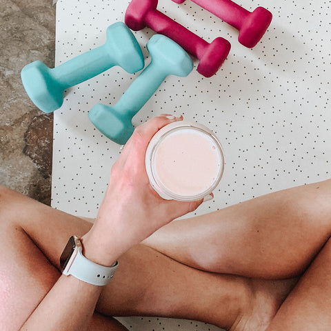 An image of a person drinking supplements.