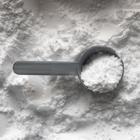 An image of a protein powder with a scooper.
