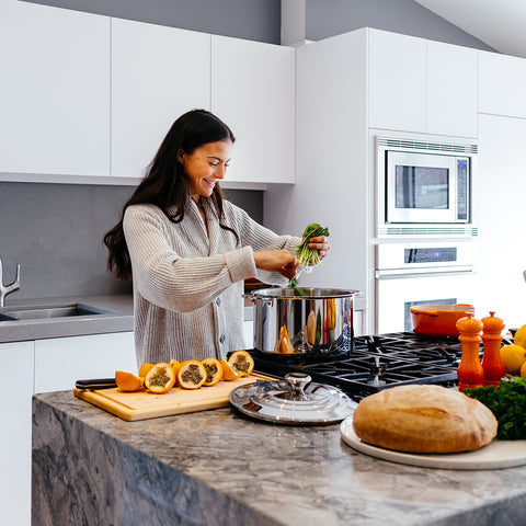 An image of a woman cooking.