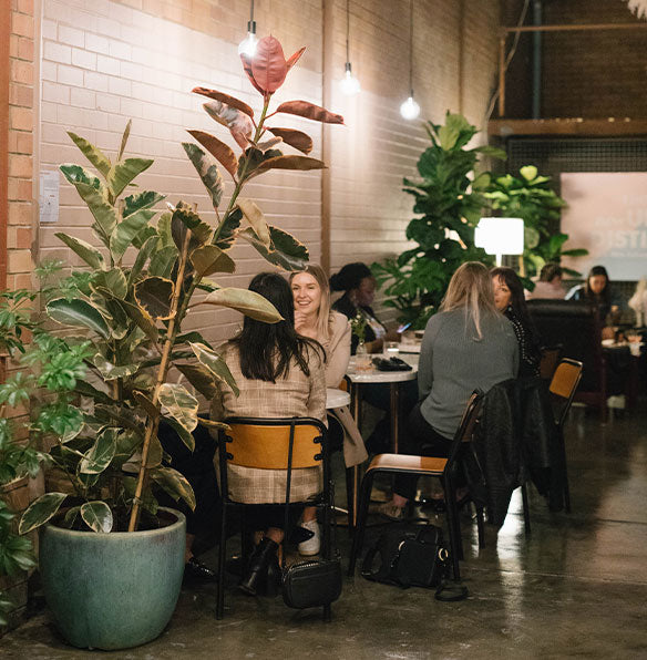Image of people sitting and drinking in the Urban Distiller