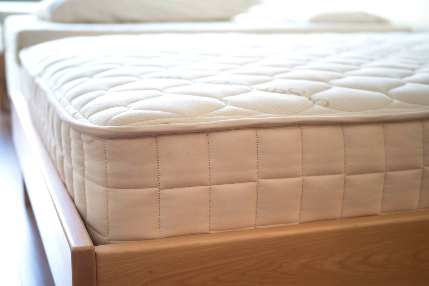 Organic coil mattresses. Natural coil mattress collection from Resthouse Sleep Solutions.