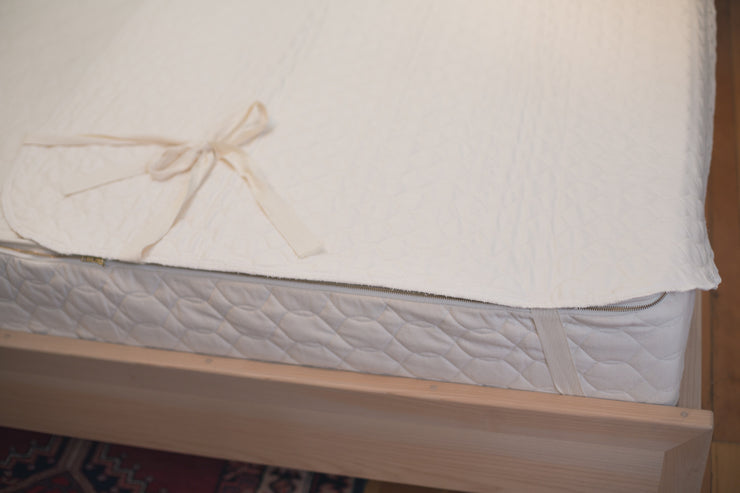 Quilted organic mattress pads by Savvy Rest