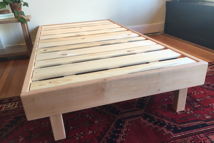Minimalist bed frame made with solid western maple.