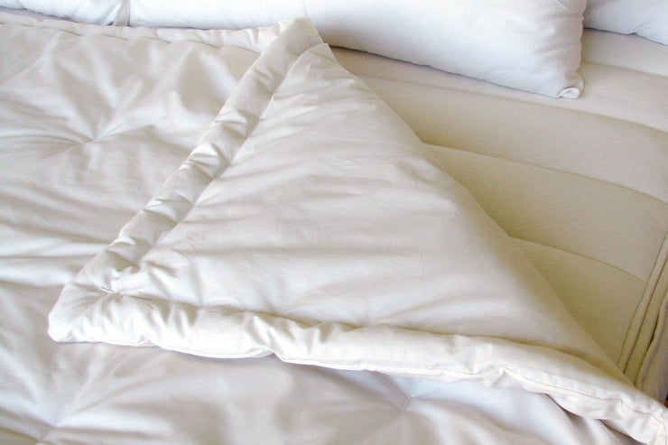 Each Holy Lamb Organics comforter is hand-made using organic sateen cotton fabric.