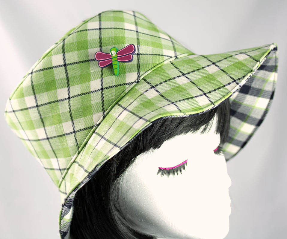 Green hat with black and white plaid. Reversible