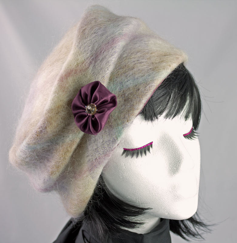 Brushed angora wool fabric, softly folded at the crown with detachable pin