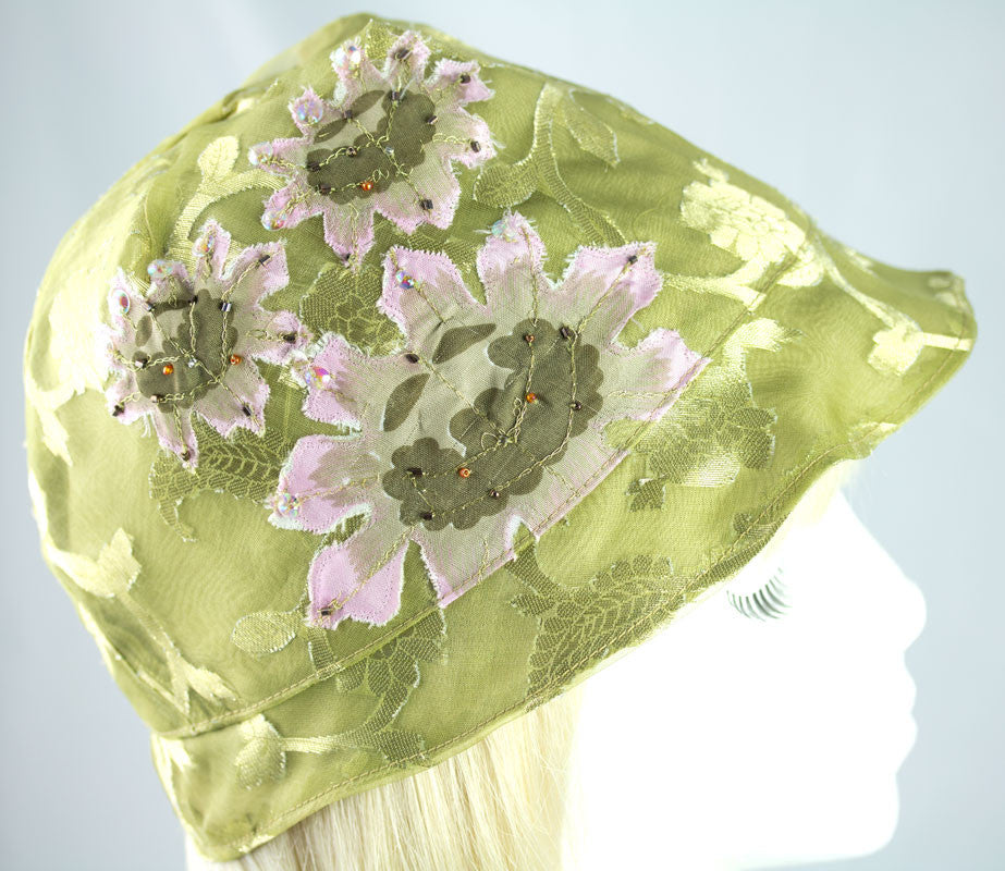 Moss green silky cloche with embellished design