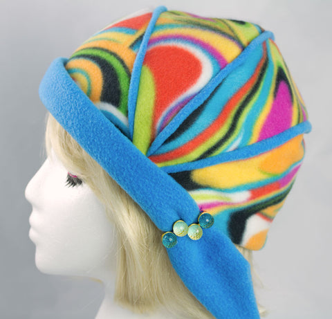 Crystal Blue Fleece Flapper Hat | Fun Rainbow Sherbet Colors with Blue Brim | Funky Beanie with Psychedelic Colors