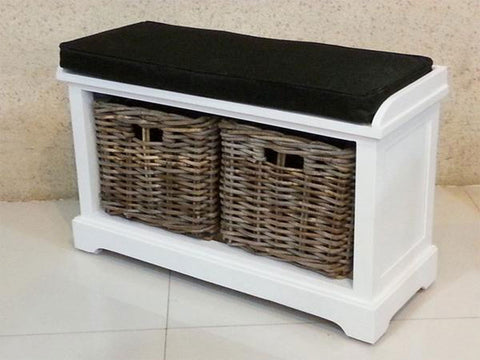 white wooden storage bench with rattan baskets and seat cushion