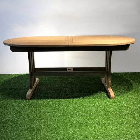 Expandable teak table oval