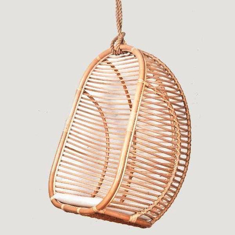 Zulu hanging rattan swing chair with dave creme