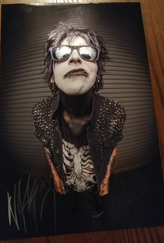Nikki Misery - Fisheye signed 8x12 (damaged)