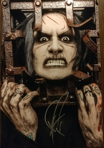 Ghost - Caged Anger signed 8x12 (damaged)