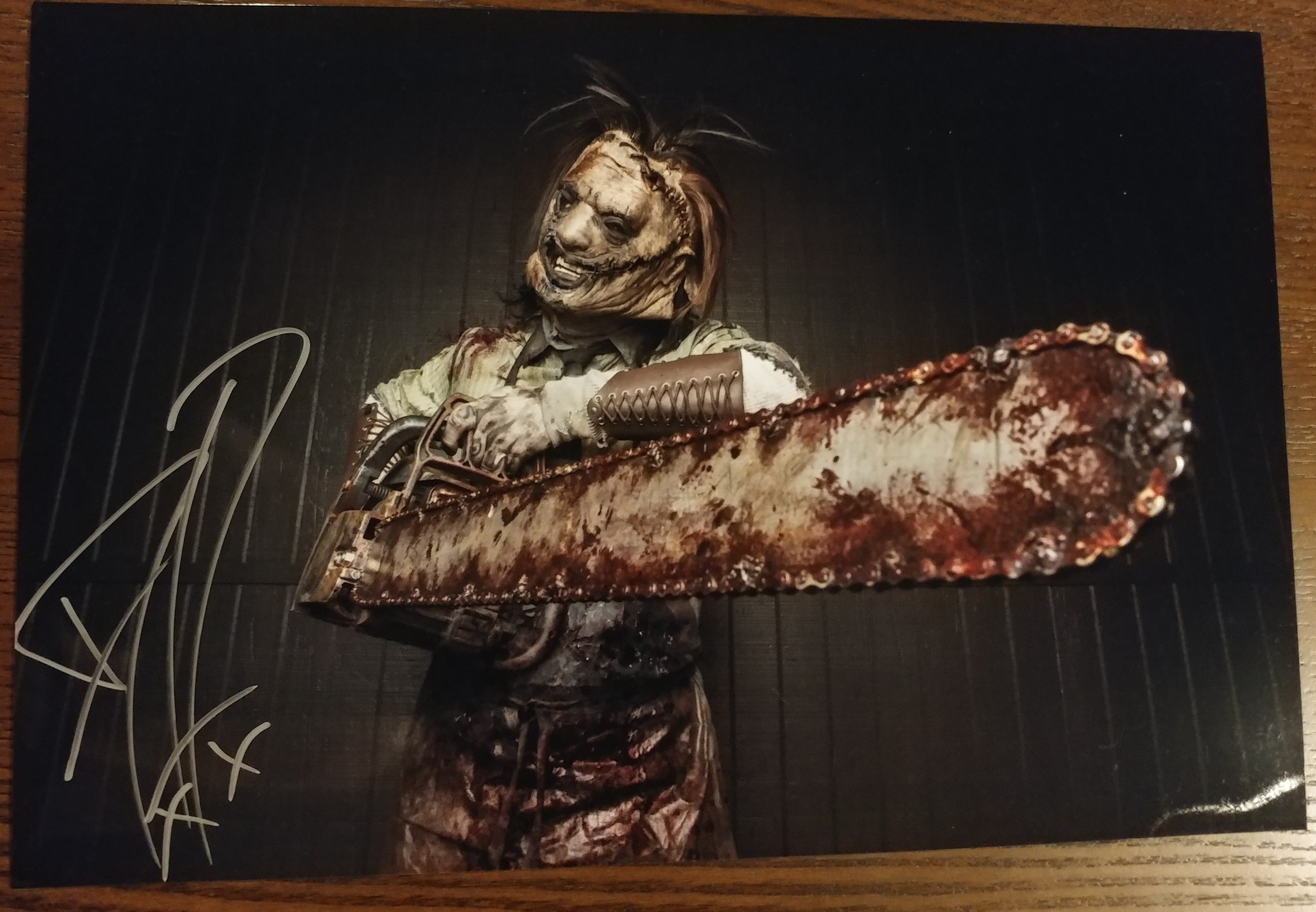 Ghost - Leatherface signed 8x12 (damaged)