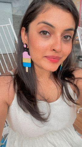 Founder of Nian by Nidhi - Nidhi Gupta - wearing Popsicle Earrings on a white dress