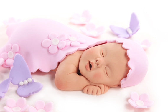 baby girl cake topper with pale pink blanket pink flowers purple