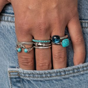 image of hand in jeans pocket with jewellery on