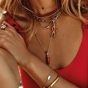 image of lady wearing red jewellery