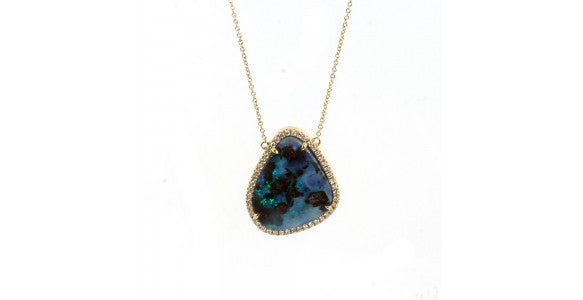 An image of a necklace with a dark blue Opal stone