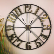 Round Metal Wall Clock Cut Out Design