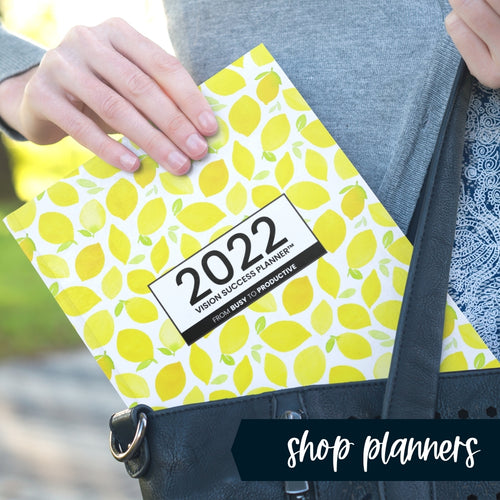 Woman pulling Make Lemonade Vision Success Planner from her purse