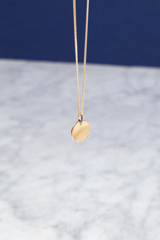 little golden disk necklace