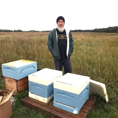 John Russell and his hive boxes