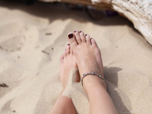 What causes dry skin on feet