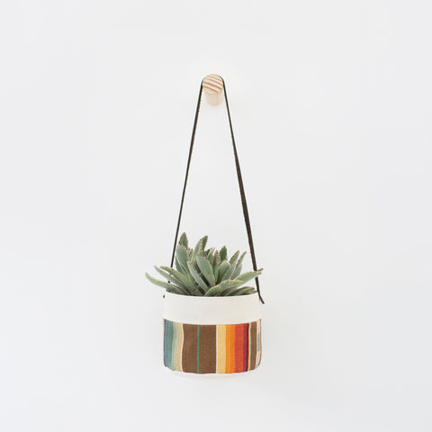 hanging canvas planter with natural wood wall peg hook