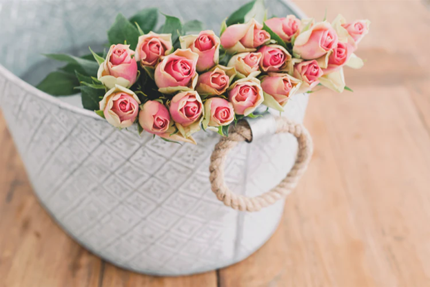 Fresh pink roses in a basket