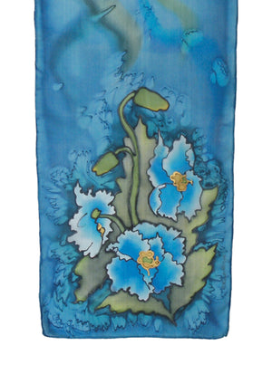 Hand-painted silk scarf with blue poppy design and blue background